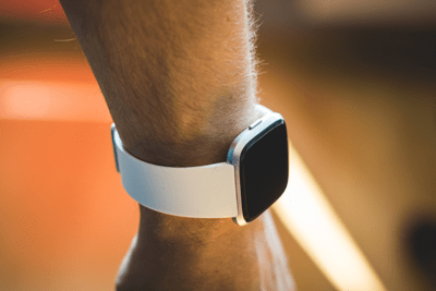 FitBit on wrist. Photo by Kamil S on Unsplash